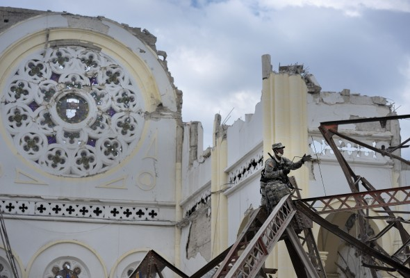 A soldier from the U.S. Second Airborne Division surveys damage inside the Cathedral of Our Lady of the Assumption in Port-au-Prince, Haiti. The church building was heavily damaged in the January 12, 2010, earthquake.