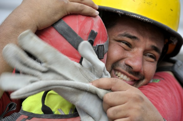 Oscar Oliva, a member of a Mexican search and rescue team, cries with joy on January 19 as he embraces a fellow rescuer after the group pulled 70-year old Ena Zizi from the rubble of Haiti's devastating earthquake, exactly one week after the city was reduced to ruins in a matter of seconds.
