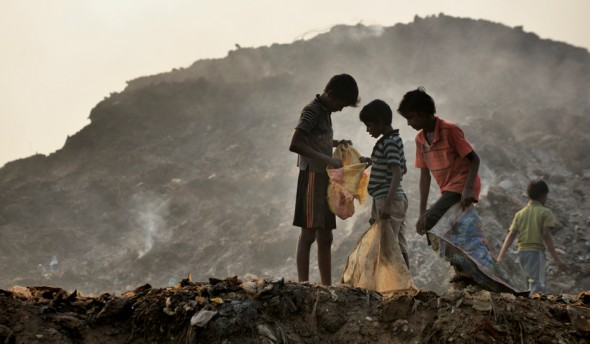 Boys scavenge in the municipal garbage dump in Chennai, India.