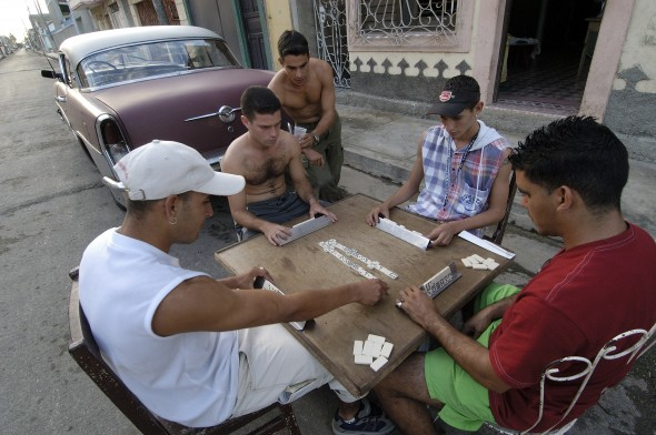 Youth playing dominoes on a street in Cardenas