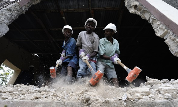 Men begin demolition of a quake-damaged school building in the rural Haitian village of Embouchure.