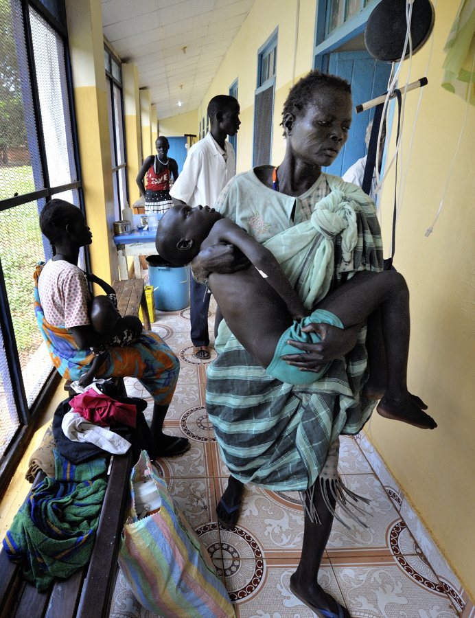 Zacarias Moses carried into hospital in Wau, South Sudan